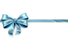 Blue Bow Gift Background. A beautiful blue ribbon and bow from a Christmas, birthday or other gift Royalty Free Stock Images