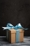 Blue bow with handmade present box Stock Image