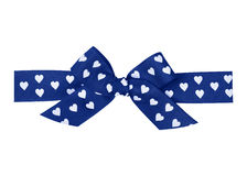 Blue bow with hearts Stock Image