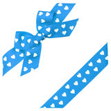 Blue bow with hearts and ribbon Stock Photos