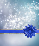 Blue Bow and Ribbon with Blue Lights. Background Royalty Free Stock Image