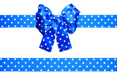 Blue bow and ribbon with white polka dots made from silk Royalty Free Stock Photography
