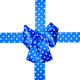 Blue bow and ribbon with white polka dots made from silk Royalty Free Stock Images