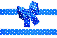 Blue bow and ribbon with white polka dots made from silk Royalty Free Stock Photos