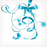 Blue bow with ribbons and snowflakes Royalty Free Stock Photos