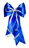 Blue bow with silver ribbon made from silk Royalty Free Stock Image