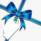 Blue bow with tag. Blue ornamental bow with white empty tag Royalty Free Stock Images