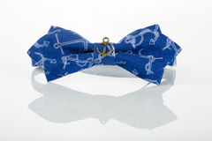 Blue bow tie with anchors Stock Photos