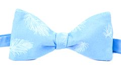 Blue bow tie with a feather pattern isolated. On white background Royalty Free Stock Image