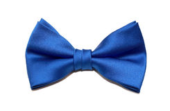 Blue bow tie isolated on white. Male blue bow tie isolated on white Royalty Free Stock Photography
