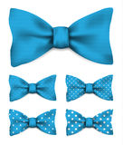 Blue bow tie with white dots set realistic vector illustration. Isolated on white background Royalty Free Stock Photo