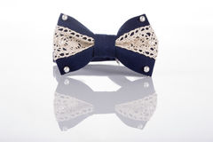 Blue bow tie with white lace Stock Images