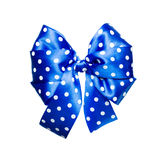 Blue bow with white polka dots made from silk Royalty Free Stock Photography