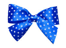 Blue bow with white polka dots made from silk Stock Images