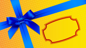 Blue bow on a yellow background Royalty Free Stock Photo