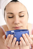 Blue bowl. Stock photo of a young woman holding blue bowl (with soup; healthy eating royalty free stock images