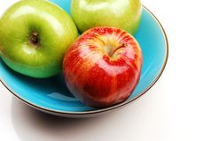 Blue bowl with apples royalty free stock images