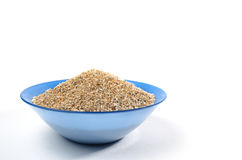 Blue bowl of barley grits isolated on white Royalty Free Stock Photo