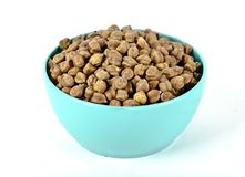 A blue bowl of black chikpeas Stock Images