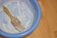 Blue bowl with a brush Royalty Free Stock Photography