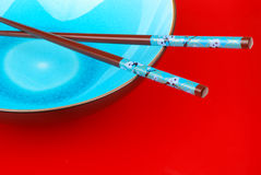 Blue bowl with chopsticks Royalty Free Stock Image