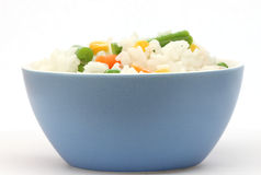Blue bowl with cooked rice with mixed vegetable Stock Photo
