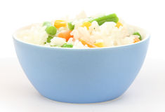 Blue bowl with cooked rice with mixed vegetable Royalty Free Stock Images