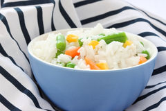 Blue bowl with cooked rice with mixed vegetable Stock Photography