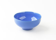 Blue bowl. Empty blue bowl on white background Royalty Free Stock Images