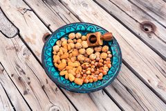 Blue bowl containing different nuts royalty free stock photos