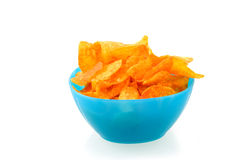 Blue bowl with paprika chips. Isolated on white background Royalty Free Stock Images