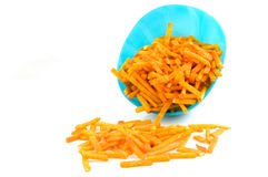 Blue bowl with paprika potato chips sticks Royalty Free Stock Photography