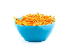 Blue bowl with paprika potato sticks Stock Images