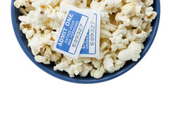 Blue bowl with popcorn and cinema tickets. Bowl of popcorn isolated on white Royalty Free Stock Photos