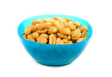 Blue bowl with salted peanuts Royalty Free Stock Images