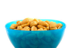 Blue bowl with salted peanuts Stock Photo