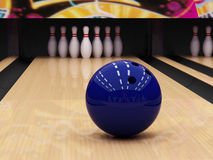 Blue bowling ball. And pins Royalty Free Stock Photos