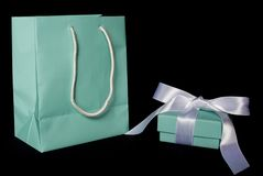 Blue box and gift bag. A fancy blue box with a white ribbon and matching blue bag Stock Image