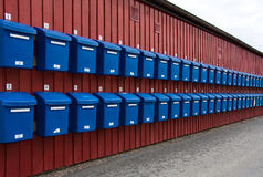 Blue box heaven. Long row of blue mailboxes Royalty Free Stock Images