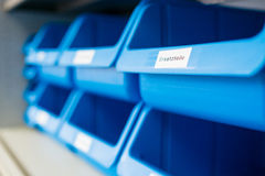 Blue box with label for spares. Blue plastic box with label for spares Royalty Free Stock Image