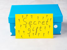 Blue box with paper card written Secret gift Royalty Free Stock Photo