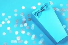 Blue box with pastel confetti stock photo