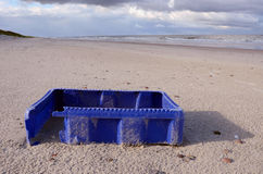 Blue box after storm on sea beach Stock Photos