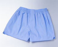 Blue boxer short over silver Stock Photos