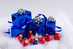 Blue boxes and Christmas blue balls. Are on the white fur Royalty Free Stock Images