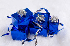 Blue boxes and Christmas blue balls. Are on the white fur Stock Image