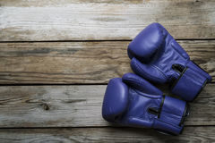 Blue boxing gloves on wood table  background. Top view, close-up Royalty Free Stock Photography