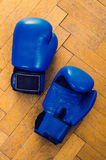 Blue boxing gloves. On the wooden floor Royalty Free Stock Photography