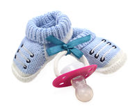 Blue boys shoes with pacifier Royalty Free Stock Image
