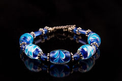 Blue Bracelet on black Royalty Free Stock Images
